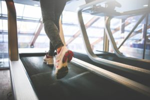 a confident woman - running on the treadmill