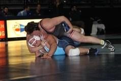 Photo by Johnnie Johnson. 285: #1 Austin Goergen (SCS) over #8 Logan Hopp (UPIO) (Fall 4:13)
