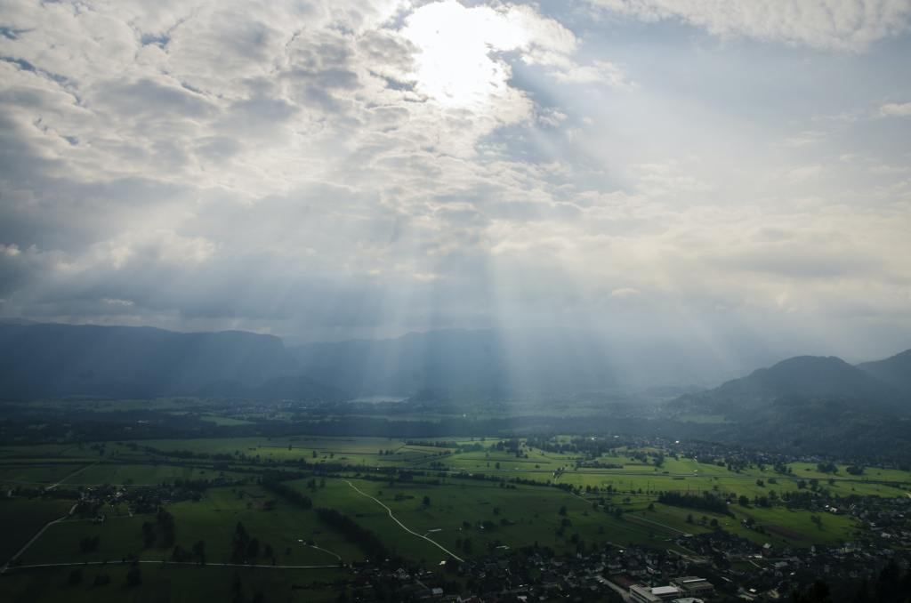 the suns rays come through the atmosphere as light and warm the earth
