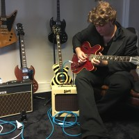 JD Simo guitar in hand interview about the Rise & Shine album