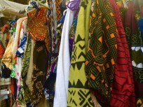 The team loved searching through these African clothes at the vendor booths. Photo by Michael Tolbert