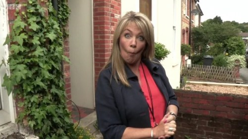 Lucy from Homes under the Hammer looking like she just sucked a lemon