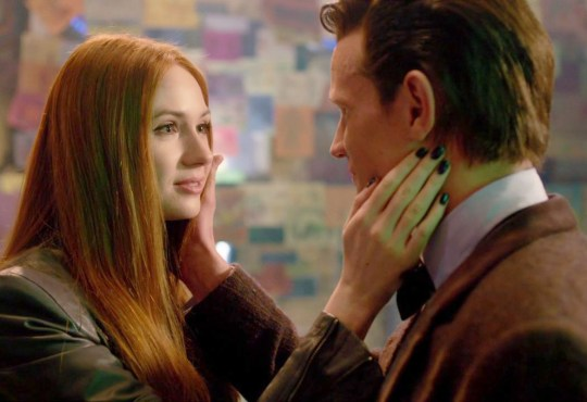Karen Gillan Matt Smith touching each other's faces in The Time of the Doctor