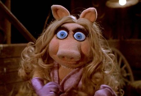 Miss Piggy looking horrified eyes wide