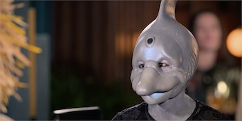 Someone dressed as a dolphin looking perturbed, from dating show Sexy Beasts