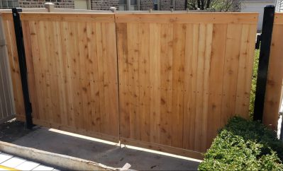 Wooden double drive gate on iron posts