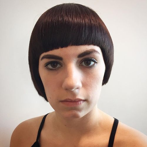 Neat Black Pixie with Straight Fringe