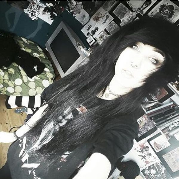 Traditional black jagged hair with a side fringe