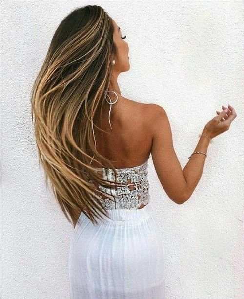 The long dark brown hair with thin blonde highlights