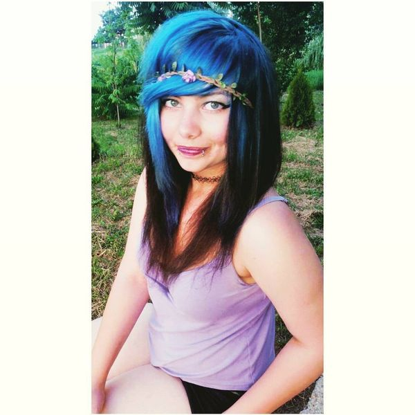 Long black hair with blue covering and flower fillet