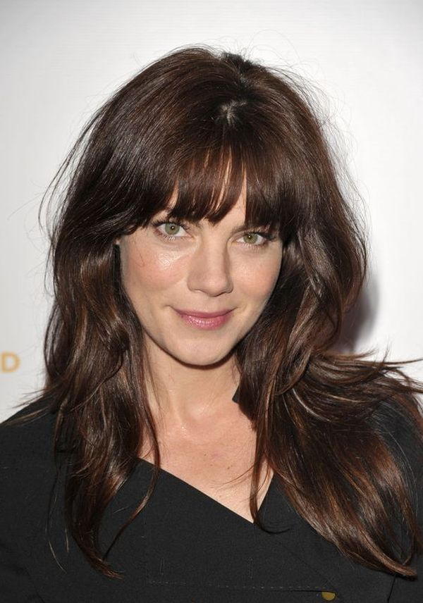 brunette layered hairstyle with arched bang