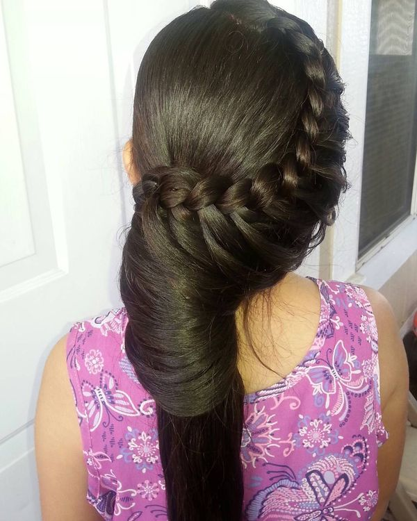 Waterfall braid with an involute ponytail