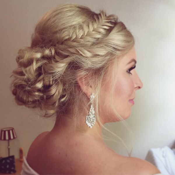 Solemn updo with a crown bride