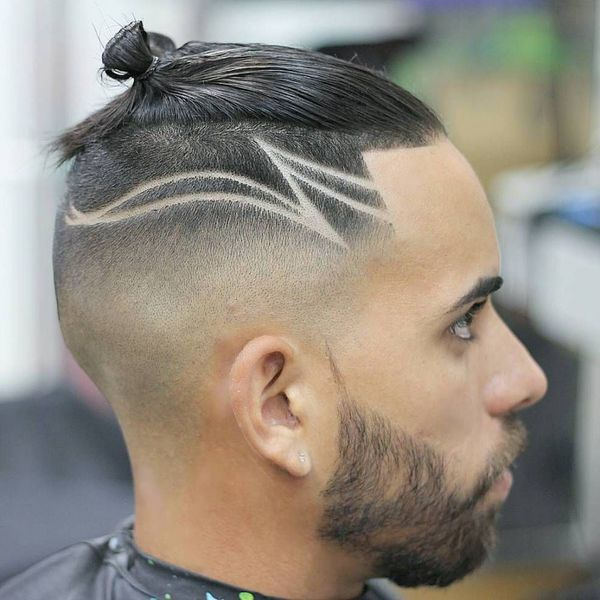 Small man bun with shaved sides 4