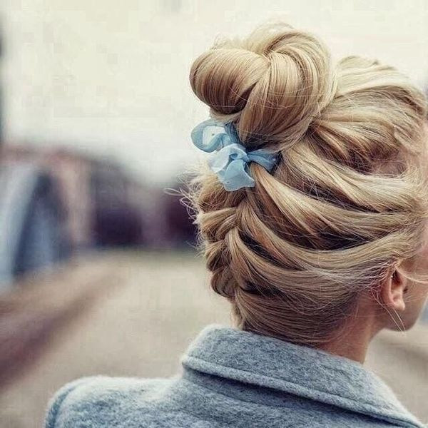Upbraided Loose Bun with a Cute Bow Accessory