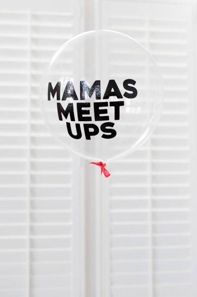 clear balloon with Mamas Meet Ups written in black