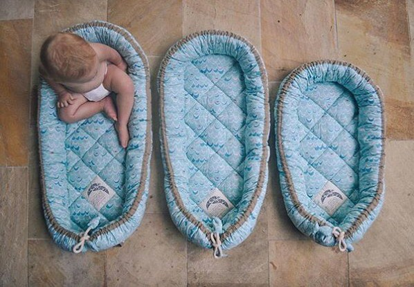 three mint green baby nests