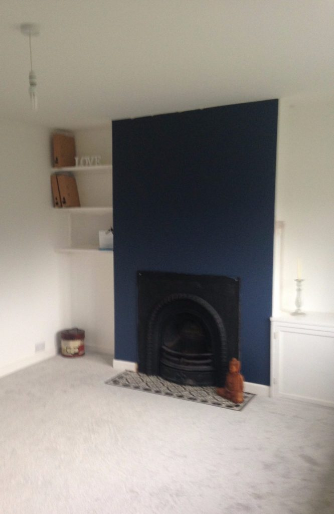 living room in progress blue chimney breast and white walls