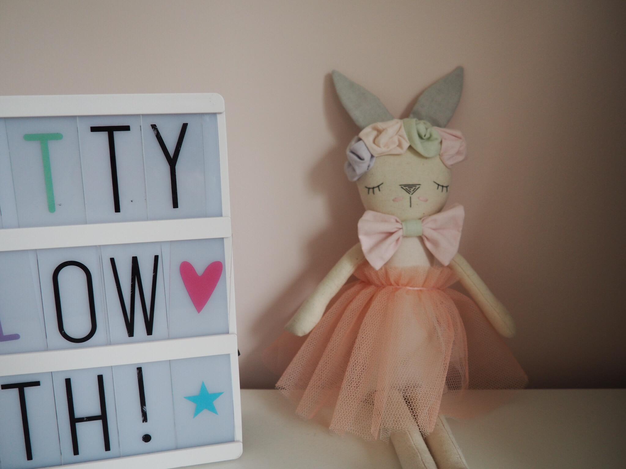 peach handmade bunny with grey ears and pink bow