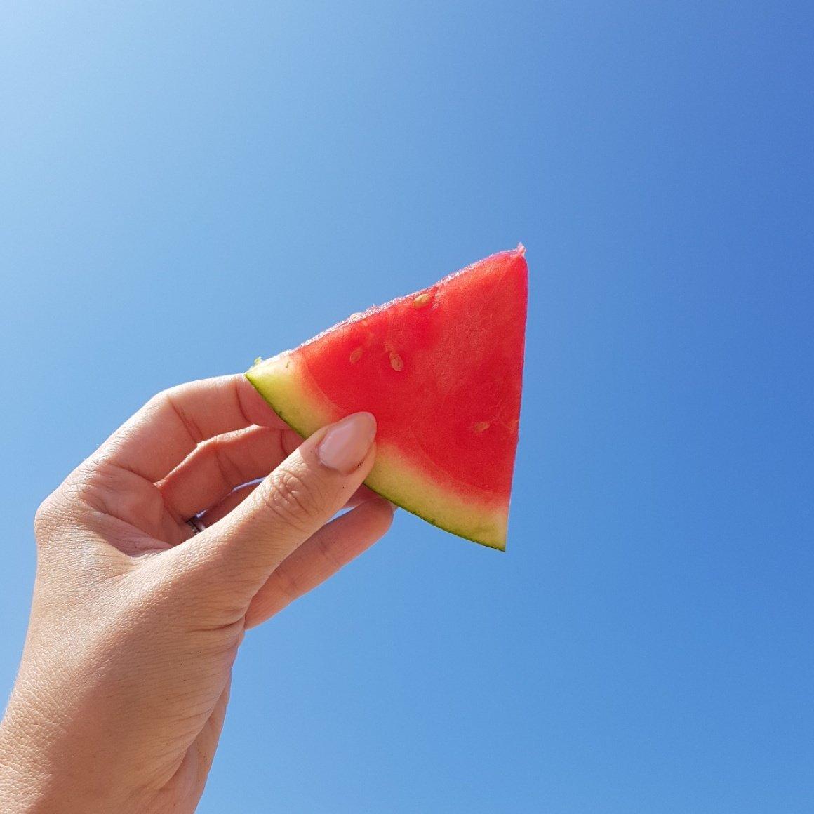 watermelon triangle against blue sky