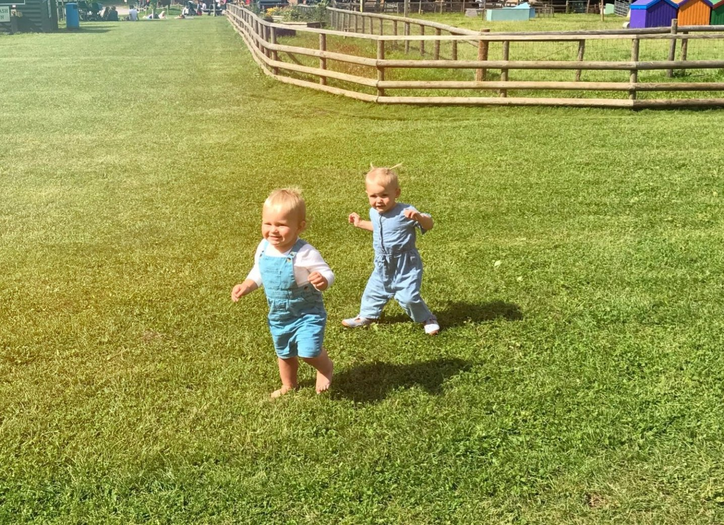 two toddlers running round bocketts farm