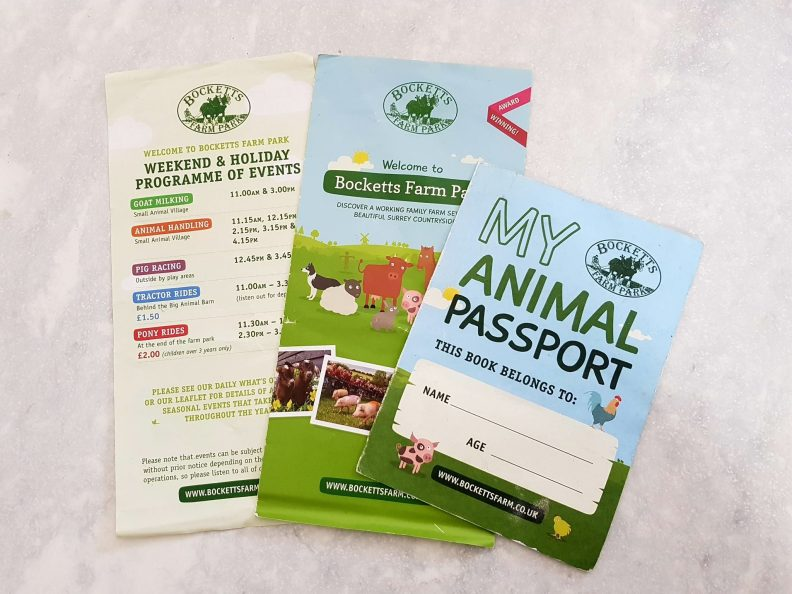 three pieces of literature from bocketts farm map, passport and event schedule
