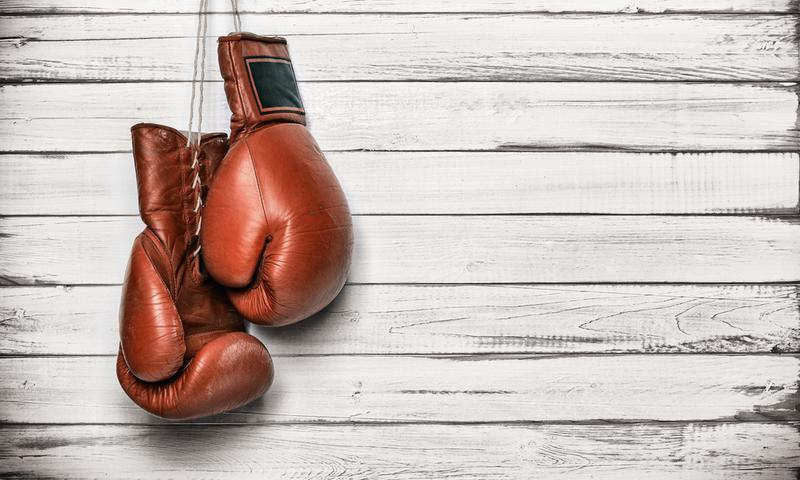 brown boxing gloves on white wooden background