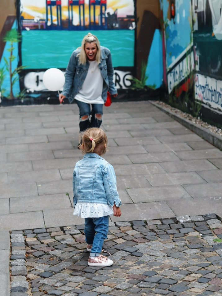 Mother and daughter laughing by street art | Hamburg with a toddler