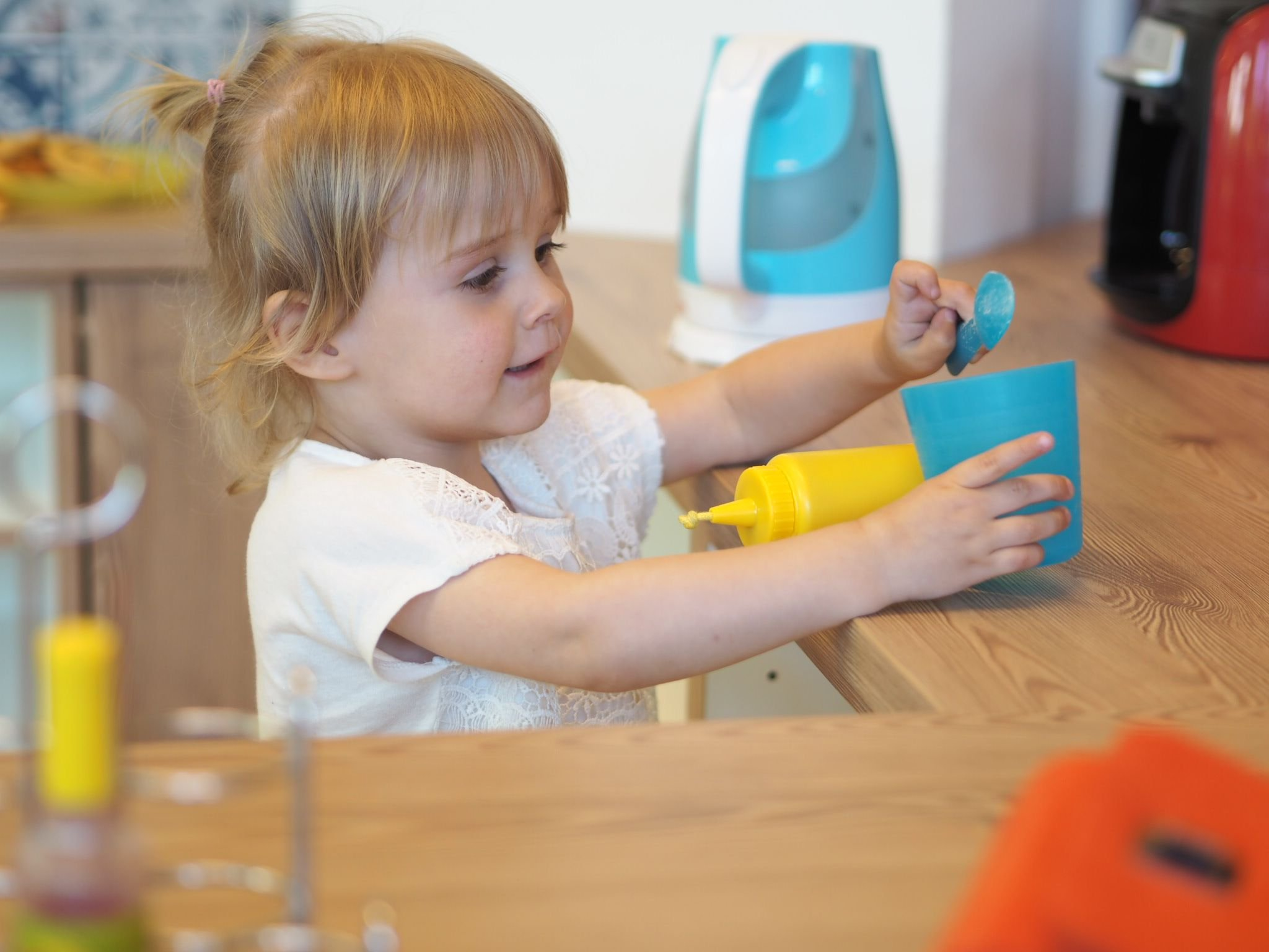 Little girl playing in pretend kitchen, Kids at work, Hamburg with a Toddler | Ettie and Me