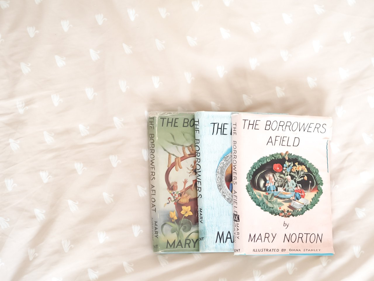 Three first edition Borrower books on a pink bed | A Modern Pink Girls room with a Scandinavian twist | The Halcyon Years