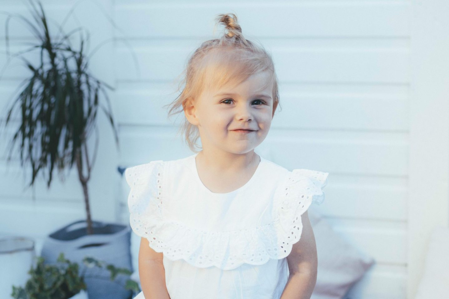 Two year old girl in white top smiling | Letters to Ettie | now you are two | The Halcyon Years