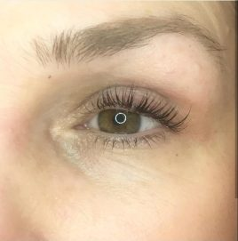 Image of a girls eye with long lashes after using revitalash advanced