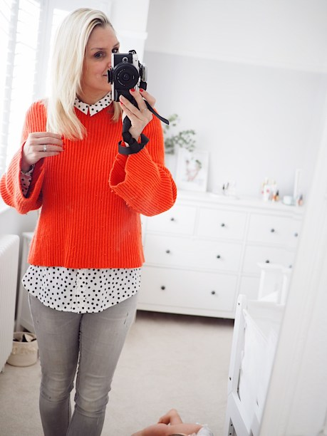 Boden staples for a capsule weekend wardrobe   The Halcyon Years [lady taking selfie in mirror wearing a red jumper and grey jeans)
