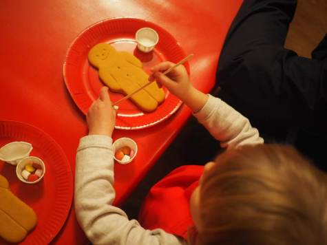 decorating gingerbread men at Tulleys Farm at Christmas