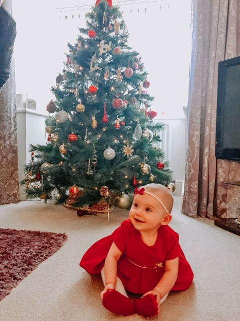 Baby girl in red christmas dress