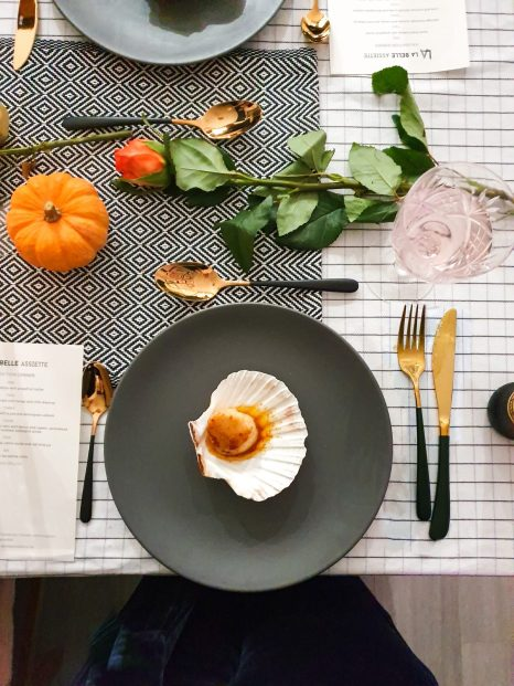 Scallop in shell on a grey plate