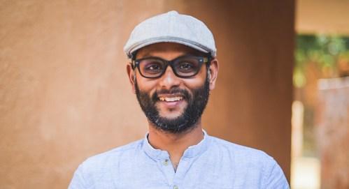 man wearing cap and smiling