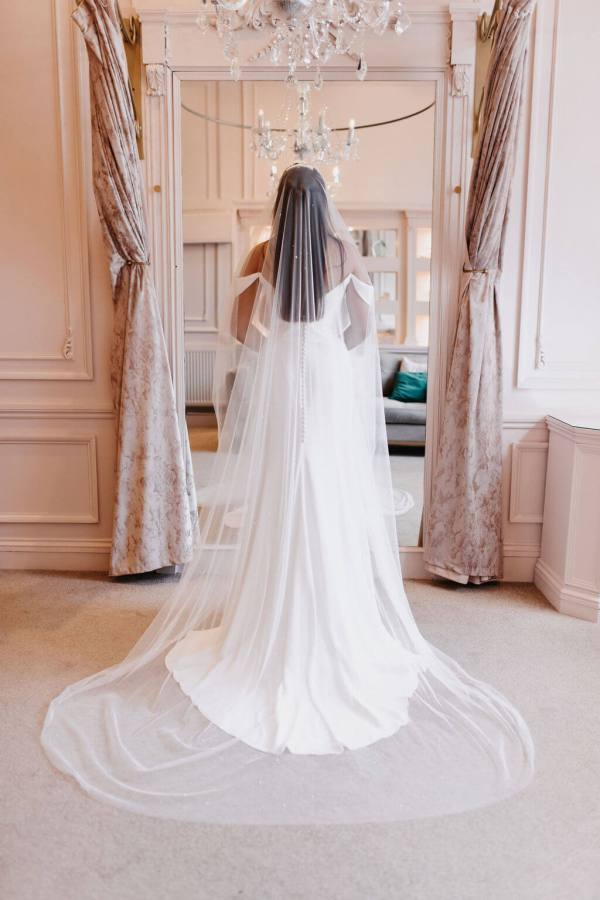 The Aurelia veil on smooth Italian Tulle with a scattering of different size Swarovski Hot Fix Pearls is available now. Click to shop.