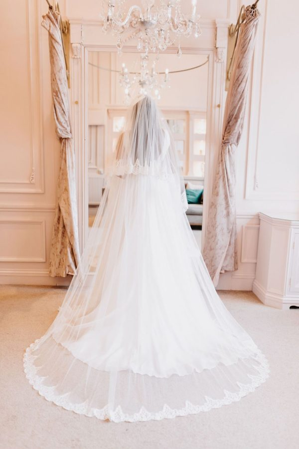 This 2 Tier veil in classic tulle is decorated all the way around both Tiers with Sophie Lace. Click to shop now.