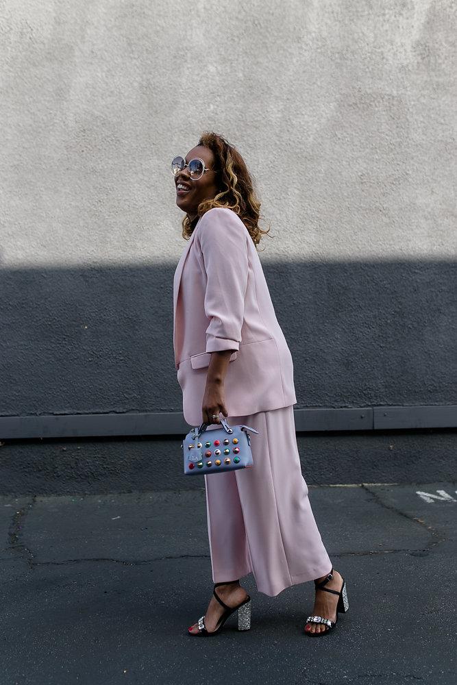 Hautemommie wears Zara pink two piece with Fendi bag