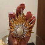 vintage brooch in hand