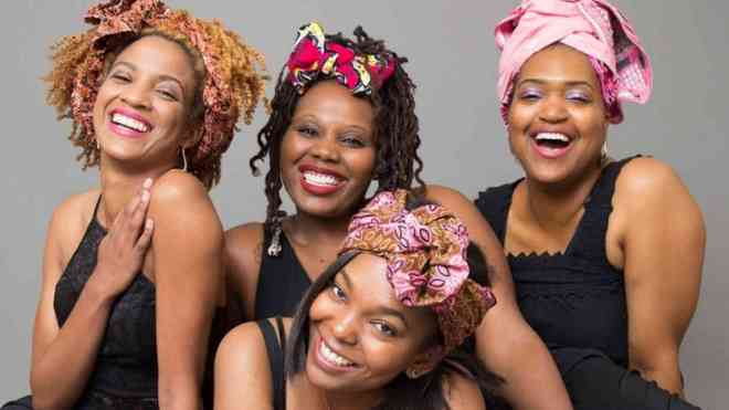 four-black-women-smiling-with-head-bands-black-history-month-2019