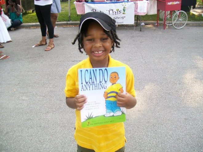 little-boy-holding-book-black-history-month