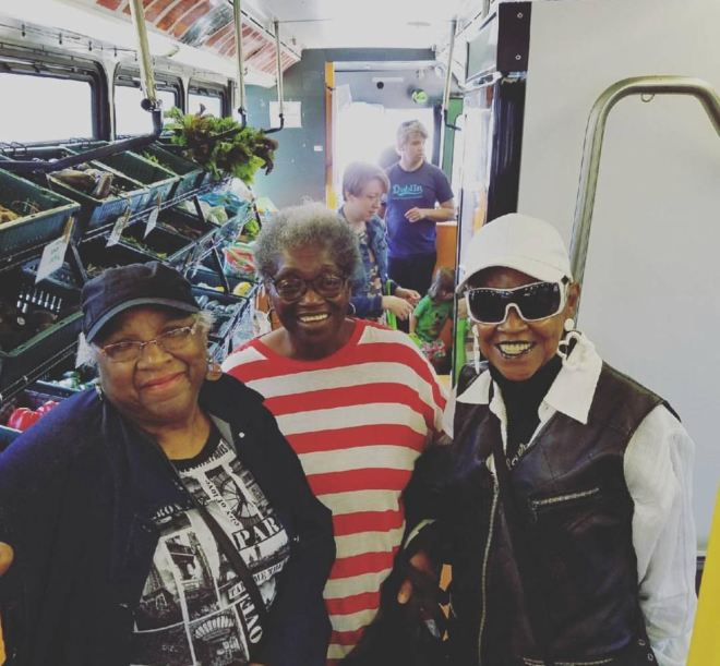 Three Black Women Smiling on the Fresh Moves Mobile Market Bus