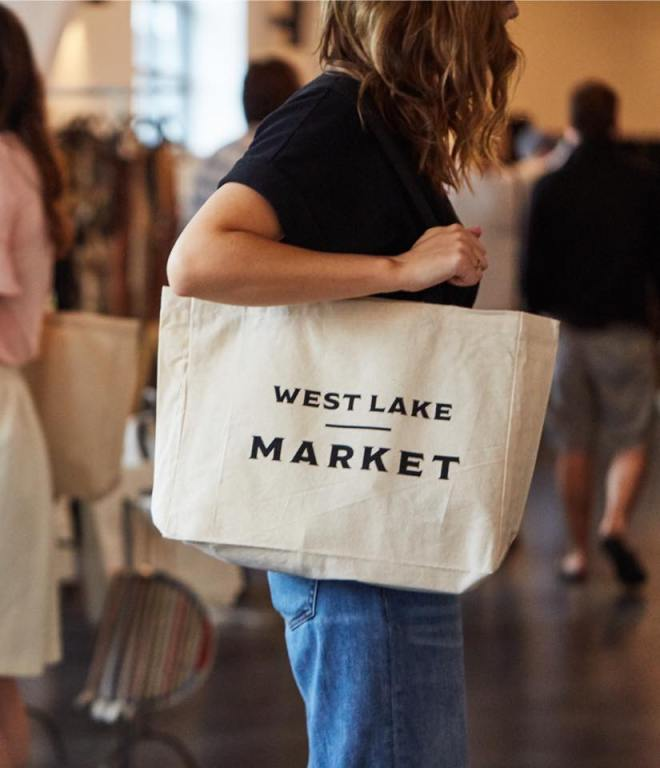 girl holding West Lake Market tote bag as featured in The Haute Seekers guide to Father's Day events in Chicago