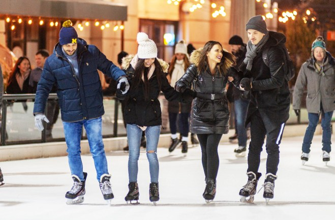 Couples ice skating at Millennium Park in Chicago as featured in the 2020 January events guide by The Haute Seeker