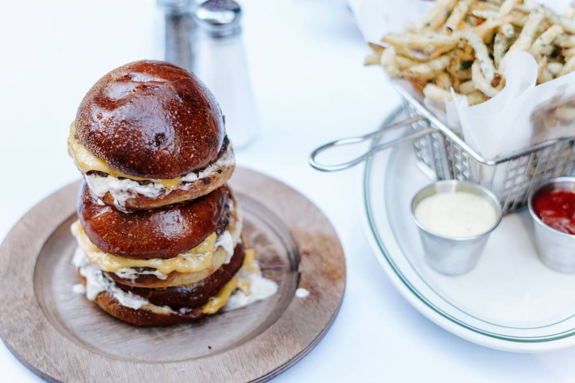 Burger and fries from Lux Bar in the Chicago Gold Coast as featured on The Haute Seeker