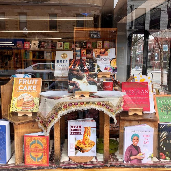 Front window of Women and Children First Bookstore featured on The Haute Seeker