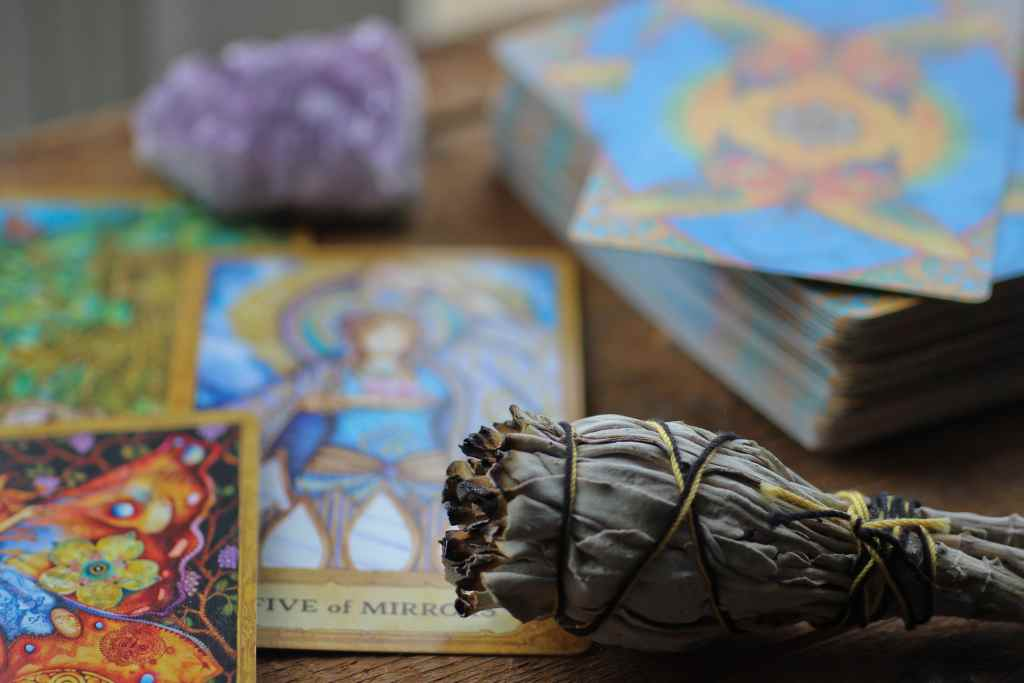 tarot cards and sage on table