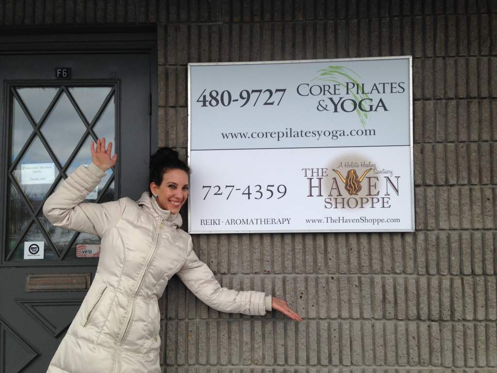 Andrea Scalisi in front of outdoor sign at The Haven Shoppe